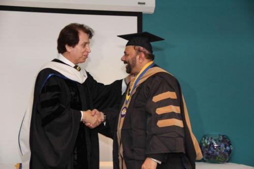 dr. Soltani congratulating Dr. Tahir